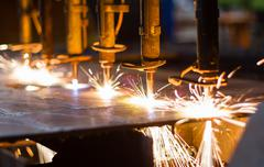 Cnc lpg cutting with sparks close up Stock Photos