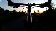 BICYCLE MOUNTAIN BIKE RIDER POV RIDING AT SUNSET 30 SECOND CLIP HD Stock Footage