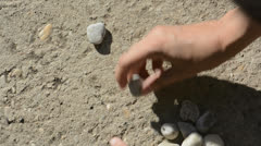 Human hands makes little heart of stones Stock Footage