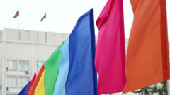 Colorful flags against building Stock Footage