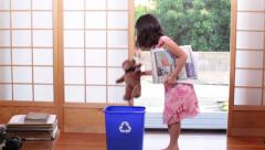 Asian Girl Recycles Newspapers and Magazines Stock Footage