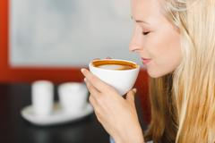Woman loves coffee Stock Photos