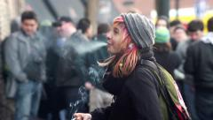 Grungy Homeless Girl with piercings smokes cigarette Stock Footage