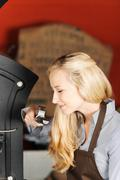 Waitress smelling coffee beans Stock Photos
