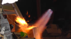 Blowtorch Being Used to Set a House Fire for a Fire Department Training Burn Stock Footage