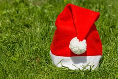 Stock Photo of santa's hat on the  grass