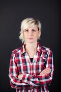 serious woman with arms crossed - stock photo