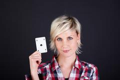 confident woman with ace of hearts - stock photo