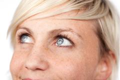 Closeup of beautiful blue eyed woman Stock Photos