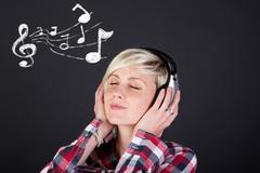 Woman with headphones and musical notes enjoying music Stock Photos