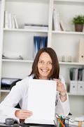 Female doctor displaying blank paper Stock Photos