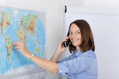 businesswoman conversing on cordless phone in office - stock photo