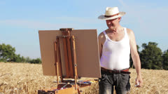 Painter in countryside landscape: field, cornfield, old, oil, brush Stock Footage