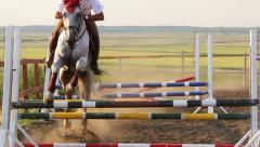 Horse jumping obstacles in slomo Stock Footage