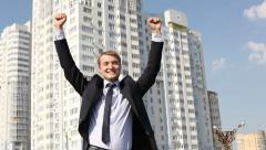 Triumphant businessman Stock Footage