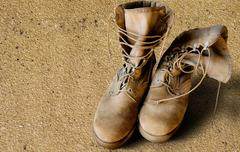us army boots on sand - stock photo