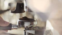 Making Ground Coffee with Coffee Grinder. Close-Up. 4K Stock Footage