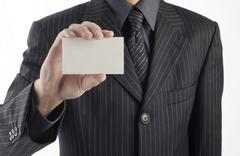 Business man handing a blank business card .for text, or your own message. - stock photo