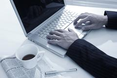 businessman man hand typing on laptop computer in office - stock photo