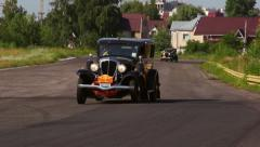 Vintage cars Rockne Six 75 Studebaker and Ford Model A on the road Stock Footage