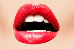 Stock Photo of beautiful female with red shiny lips closeup