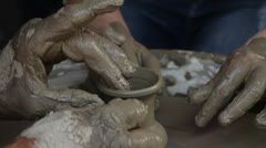 hands and clay - stock footage