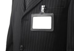 blank id card on suit - stock photo