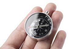 Hand holding the compass close up shoot Stock Photos