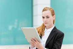 young businesswoman using digital tablet - stock photo