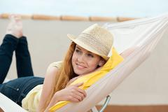 Happy woman daydreaming in hammock Stock Photos