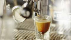 Cup of Espresso Being Poured from a Professional Espresso Machine. Close-Up .4K Stock Footage