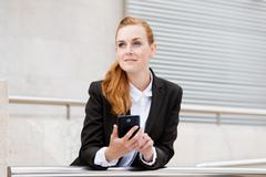Smiling attractive woman with smartphone Stock Photos