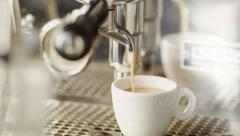 Cup of Coffee Being Poured from a Professional Espresso Machine. 4K Stock Footage