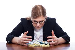 Woman with many pills Stock Photos