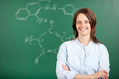 arms crossed teacher - stock photo