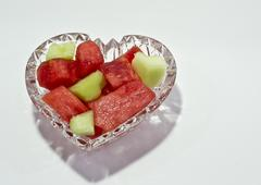 Melons in a Heart Bowl Stock Photos
