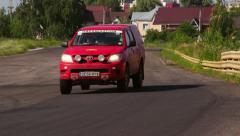 Red cat looking as a fire truck or emergency on the race track Stock Footage