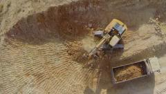 Excavator and loader in a construction site-  Aerial Shot Stock Footage