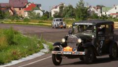 Ford Model A and Packard Six, Peking to Paris rally. Vintage cars competing Stock Footage