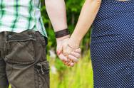 Stock Photo of Man with a woman there for each other's hand