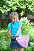Happy caucasian child looking in butterfly net Stock Photos