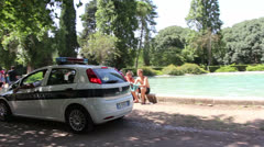 Villa Borghese swimmers and police - stock footage