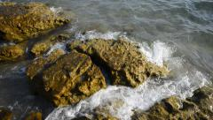 the sea shore. rocky ocean coast is splashed by water - stock footage