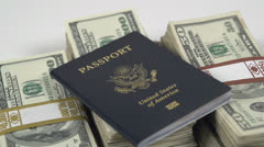 Passport sitting on stack of cash Stock Footage