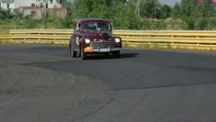 Ford Super Deluxe driving slowly at countryside Stock Footage