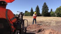 Construction forman, equipment operator Stock Footage