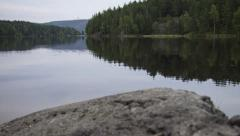 Quiet countryside lake motion time lapse Stock Footage