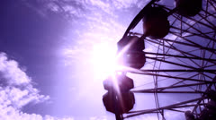 FERRIS WHEEL SILHOUETTE WITH SUN FLAIR  HD 1080 - stock footage