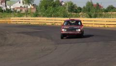 Rare vintage auto Datsun P510 driving over the village. Peking to Paris rally Stock Footage