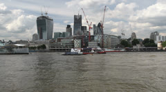 Boats and new additions to the London skyline Stock Footage